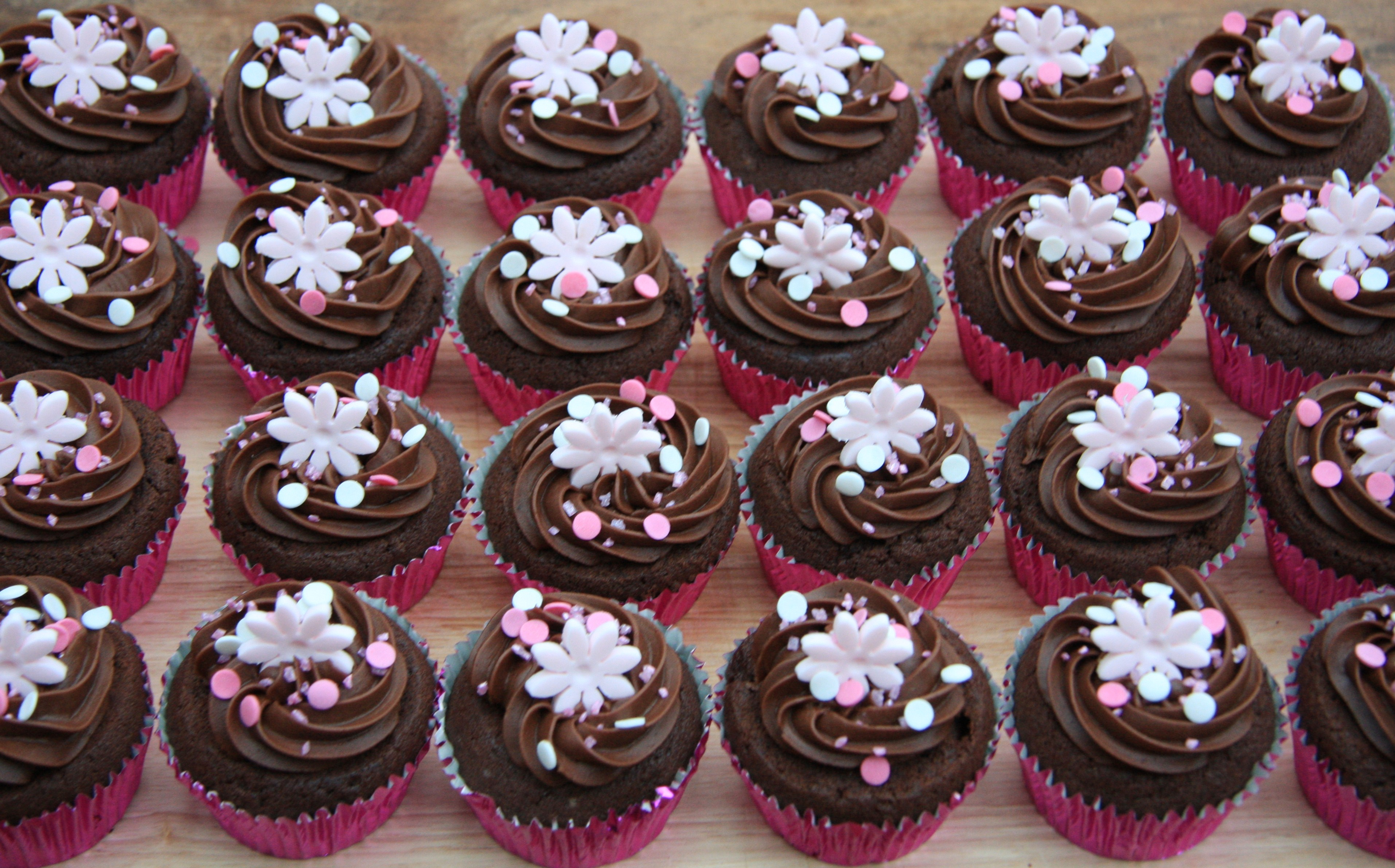 Chocolate Party Cupcakes With Pink Flower Decorations Lovinghomemade